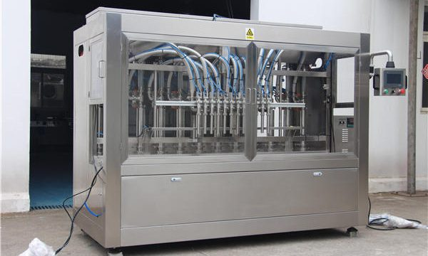 Напълно автоматична машина за пълнене на мед в бутилки